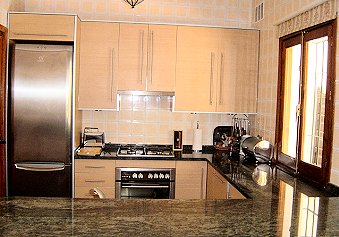Modern kitchen with all amenities at Mijas Golf
