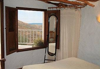 Polopos holiday house  bedroom with access to the terrace